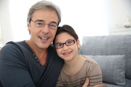 single father: Portrait of man with his 8-year-old daughter