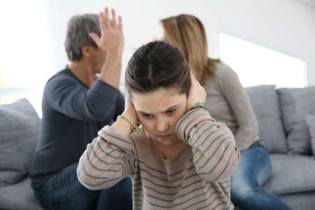 Parents fighting and daughter being upset photo