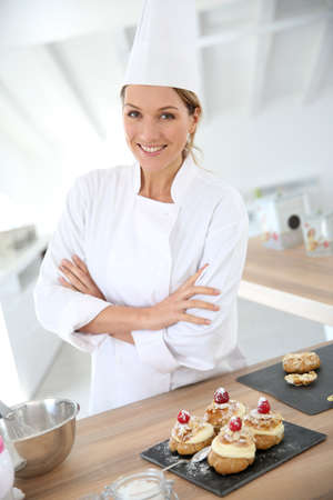 Successful woman confectioner in professional kitchen photo