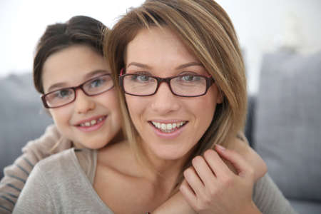 blonde mom: Portrait of mother and daughter with eyeglasses