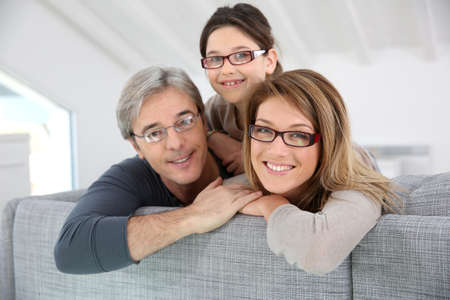 glass house: Portrait of happy family wearing eyeglasses