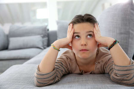 Little girl on couch looking to the ceiling