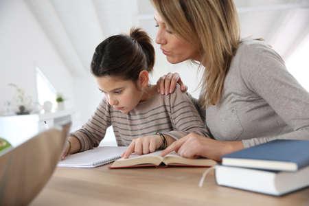 homework: Mom helping kid with homework