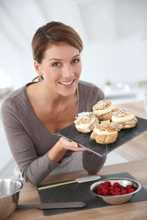 Portrait of beautiful woman baking pastry at home photo