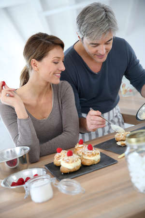 Couple preparing pastry together at home photo