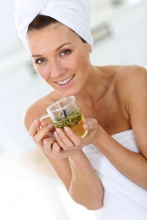 woman drinking tea: Portrait of beautiful woman drinking herbal tea