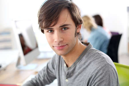 college boy: Portrait of college boy sitting in class Stock Photo