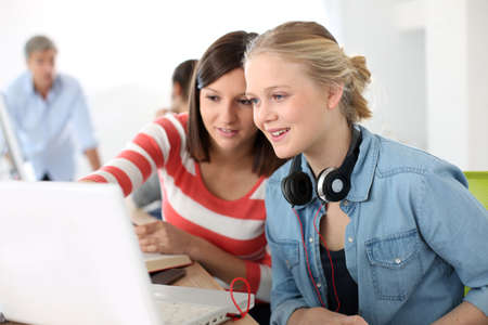 Students girls studying together on laptop Stock Photo