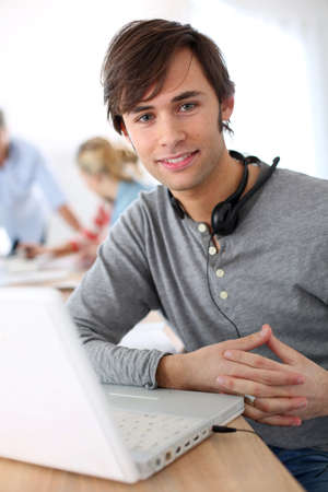 skype: Student with headset on doing English language test Stock Photo