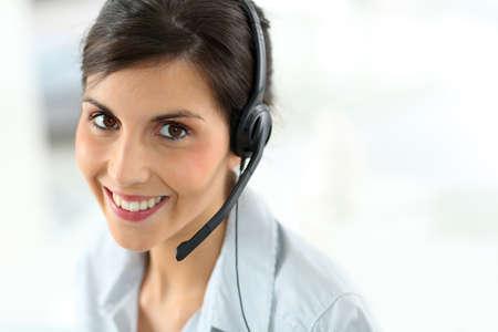 Portrait of beautiful customer service representative photo