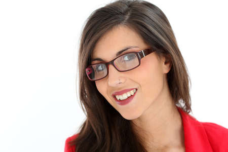 Attractive brunette woman with red jacket and eyeglasses photo