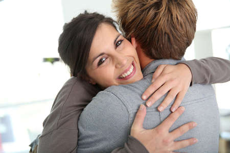 reunion: Couple embracing, happy to get back together Stock Photo