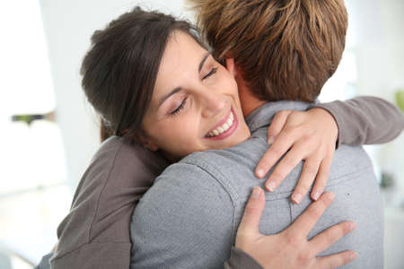 welcome home: Couple embracing, happy to get back together Stock Photo