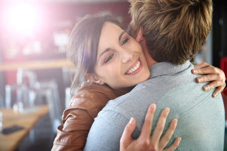 Brunette girl happy to see her boyfriend again Stock Photo