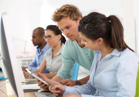 group of young adults: Group of young adults in business training