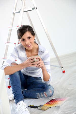 having a break: Brunette girl having a break while renovating home