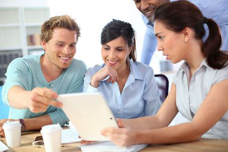 Young business people meeting around table Stock Photo