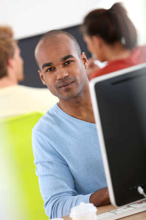 Man working on desktop computer photo