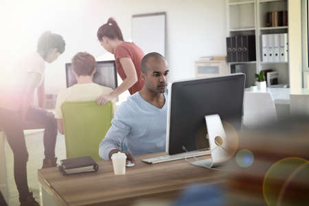 Man working on desktop computer Stock Photo