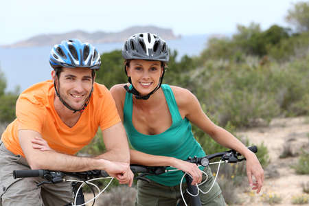 Portrait of couple on a biking day in Ibiza island photo