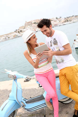 websurfing: Couple of tourists websurfing with tablet, town of Ibiza