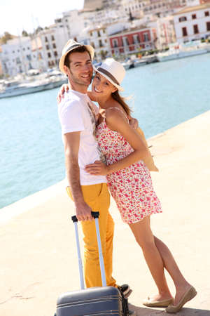 Cheerful couple getting of the boat in Balearic island Stok Fotoğraf