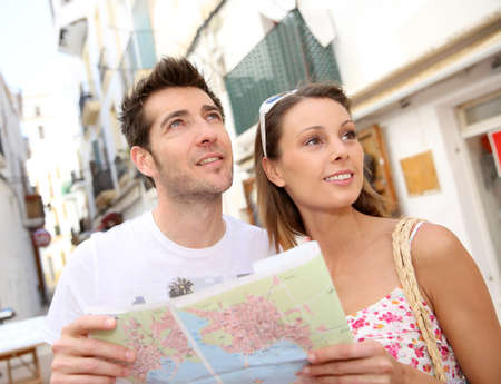 Couple of tourists visiting city street of Ibiza photo