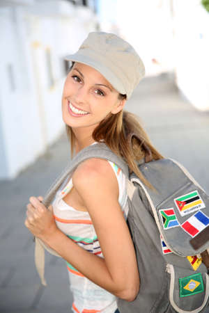 globetrotter: Trendy girl with backpack traveling in Europe