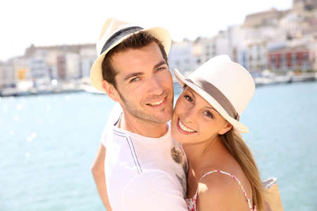 adult couple: Portrait of cheerful couple traveling to balearic island Stock Photo