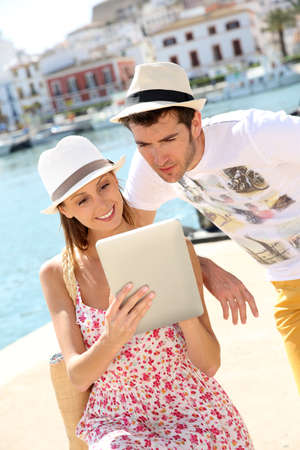 websurfing: Couple of tourists websurfing with tablet