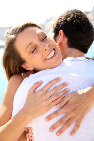 get together: Couple hugging and being happy to get together Stock Photo