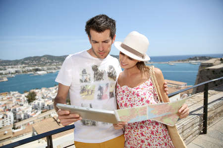 Couple of tourists reading map at the top of Ibiza old town photo