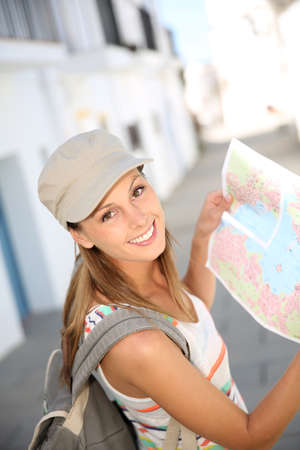 globetrotter: Tourist girl holding city map