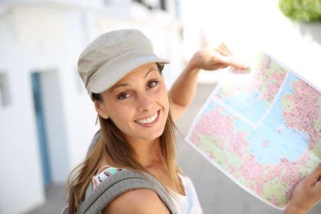 Tourist girl holding city map photo
