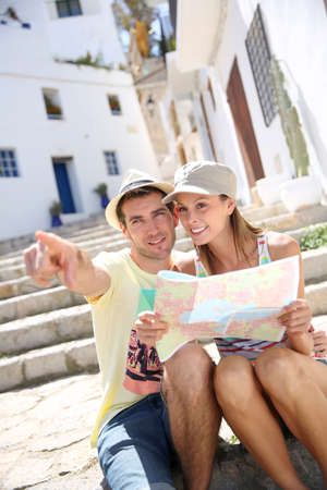 Tourists enjoying typical architecture of Ibiza island photo