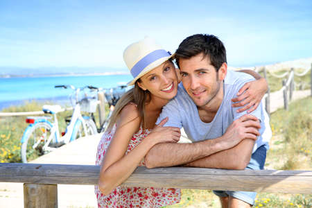 Portrait of sweet couple spending vacation on island photo