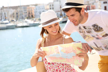 Couple in vacation looking at city map photo