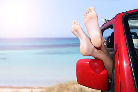 beach feet: Relaxing vacation by the beach Stock Photo