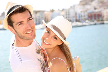 Portrait of cheerful couple traveling to balearic island photo
