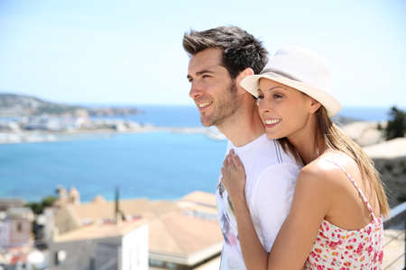 Happy couple of tourists visiting Ibiza island in summer