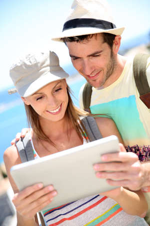 Couple of travelers connected with digital tablet