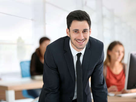 sales executive: Portrait of young businessman in office Stock Photo