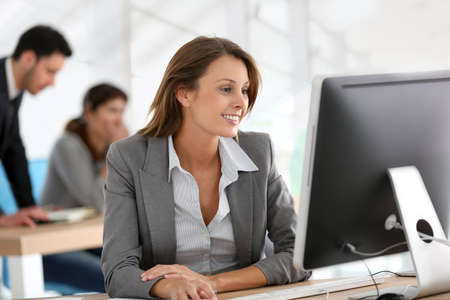 Businesswoman working on desktop computer Stock Photo