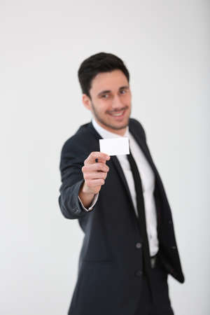 businesscard: Smiling businessman giving businesscard to client