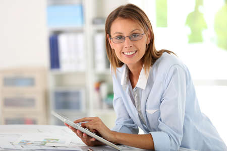 28044684: Woman architect working in office on project