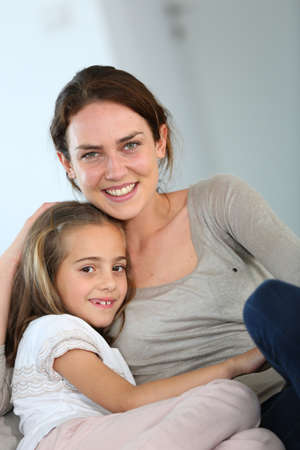 Portrait of mother and daughter in tender moment photo