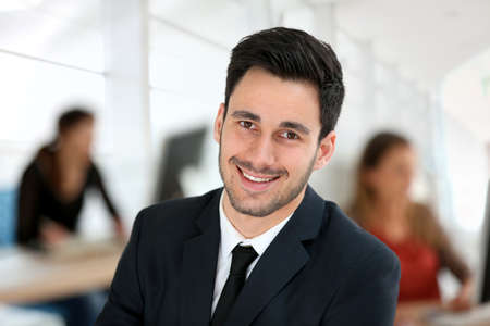 Portrait of young businessman in office photo