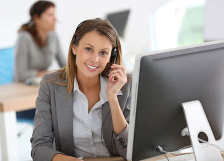 Smiling customer service representative at work Stock Photo