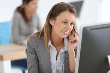 international sales: Smiling customer service representative at work Stock Photo
