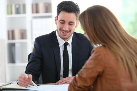 financial adviser: Woman meeting financial adviser in office